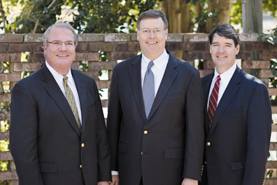 Jim Edwards (center) with his cousin John Edwards (left), United Bank's chairman, and brother Chris Edwards, United's CIO.