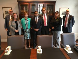 Rep. Raja Krishnamoorthi (D-Ill., center) visits Itasca Bank and Trust.