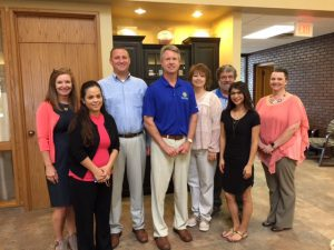 Rep. Roger Marshall (R-Kan., center) visits First National Bank of Elkhart.